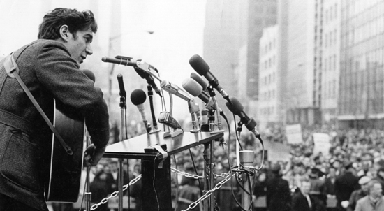 """Phil Ochs during aVietnam moratorium demonstration outside U.N. Building (New York City, 1967).  """"Phil Ochs: There but for Fortune"""", afilm byKenneth Bowser. AFirst Run Features release.  Photo byMichael Ochs."""