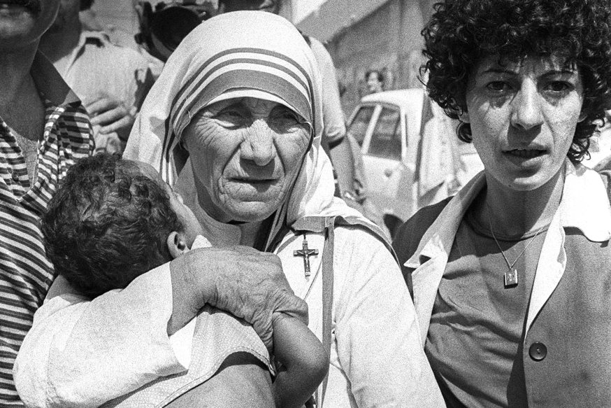 Peace Nobel Prize Mother Teresa hugs a child in West Beirut 14 August 1982. Mother Teresa visited the children who were in the Islamic Home which was shelled during the Israeli attacks on West Beirut. The children are now being evacuated to the mountains after living for several days without food and water. Mother Teresa will be beatified, 19 October 2003, in a ceremony in St Peter's Square, Vatican. The beatification ceremony is the penultimate step to being canonised a saint and has been the shortest in modern history. Following the beatification, a second miracle has to be verified by the Vatican before Mother Teresa can be proclaimed a saint. AFP PHOTO DOMINIQUE FAGET / AFP / DOMINIQUE FAGET